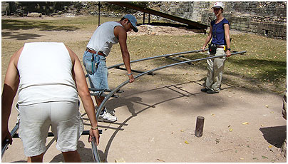 Producer Rosey Guthrie and the grips lay dolly track at Copán.
