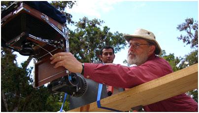 Director Lebrun adjusts the 8x10 still camera over a carved altar at Copán.