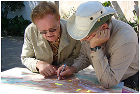 Anthropologist Dennis Tedlock (left) and director Lebrun plan a route in the Guatemalan highlands.