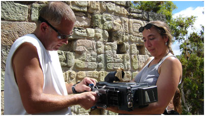 Cinematographers Steven Kline and Amy Halpern adjust the Panasonic SDX900 camera at Copán.