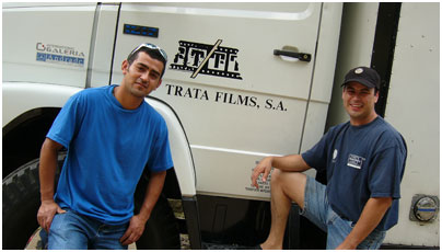 Grip-electricians Raul Salazár and Javier Guadarrama with the equipment truck from Panavision.