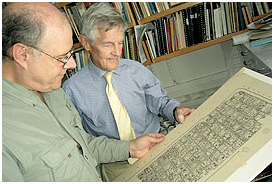 Ian Graham (right), Director of Harvard's Maya Corpus Project, shows film director David Lebrun his drawing of a Maya inscription.